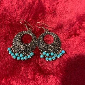 Dark ear rings with turquoise color beads